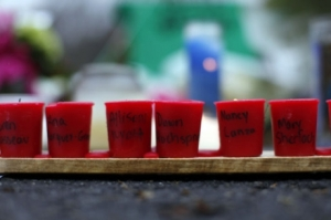 Candles penned with the names of Sandy Hook victims are lined up at a vigil after the shooting.